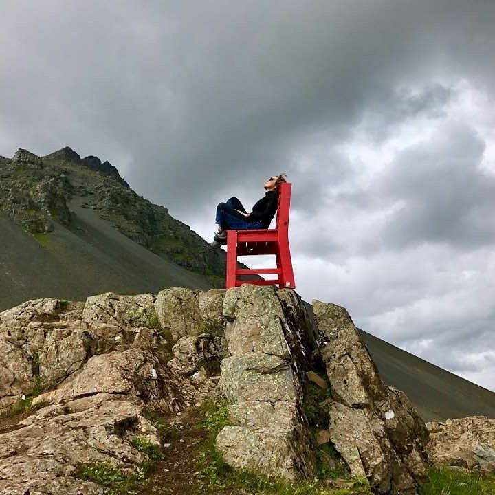 I don't know about you but am just chilling out here in my big red chair enjoying my summer vacation. So where are you right now ? #redchair #Iceland #travelblogger #travel #summer #happy