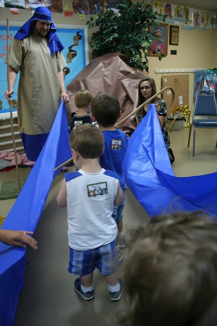 """Red Sea - Crossing the sea on dry ground. Children take turns being Moses and rest of class follows through the """"sea"""". All young classes."""