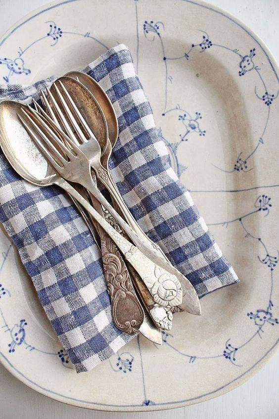 Beautiful blue gingham napkins with vintage silverware and plate