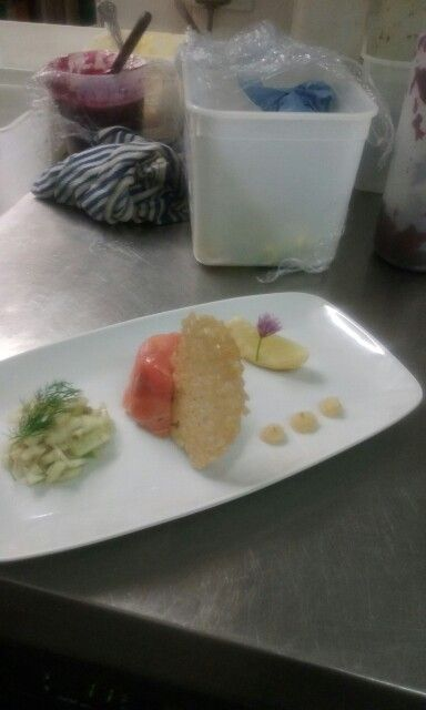 Salmon and crab tian,fennel and Apple salad.Apple puree.parmesan tulle