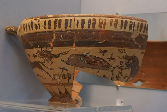 A Greek wine cup showing a large dog, scorpion, dolphin and a panther/lion, possibly symbolizing con... - John Barnes