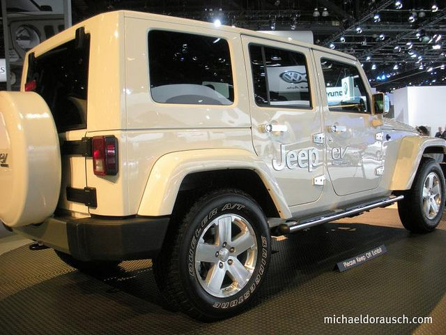 Jeep Wrangler Four Door- all white with a white hard top. Why can't it be mine now?!