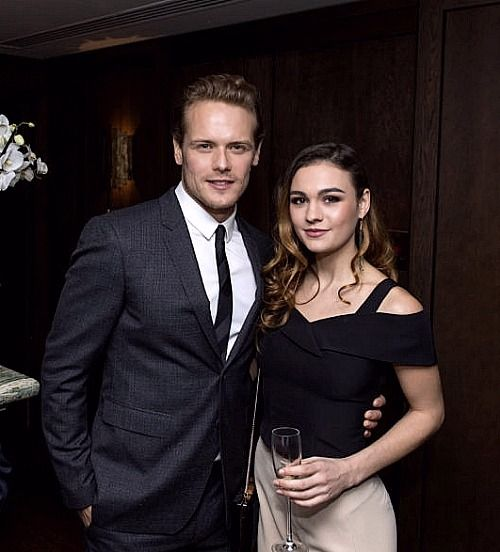 """Sam Heughan with Sophie Skelton attending HFPA Golden Globes Party in London 