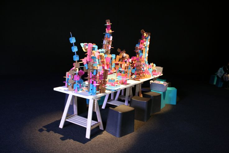 """Buildscapes at Powerhouse Museum.  Flex your creative muscle while building imaginary cities using beautiful geometric configurations made from slotted cardboard puzzle pieces. Inspired by George Nelson's """"jungle gym"""" structure for the American National Exhibition, Moscow. See how the city develops over the course of Sydney Design as you add you own cubed and slotted designs to contribute to a collectively designed urban landscape."""