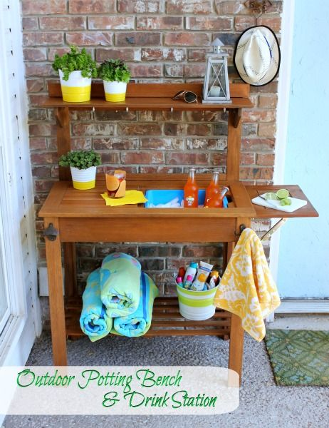 Use a garden potting table to cool drinks! GENIUS IDEA. We need this desperately near our pool, as we've also got our gardening center down there! LOVE THIS.