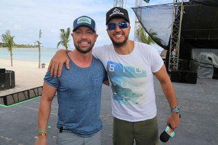 Cody Alan (left) and Luke Bryan pose during Bryan's Crash My Playa Festival.