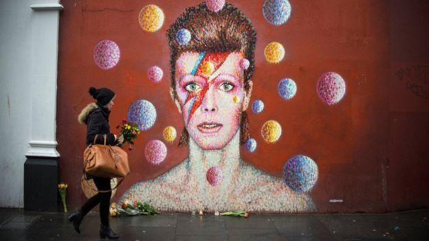 Flowers left for David Bowie at a mural to the singer in his birthplace of Brixton, south London