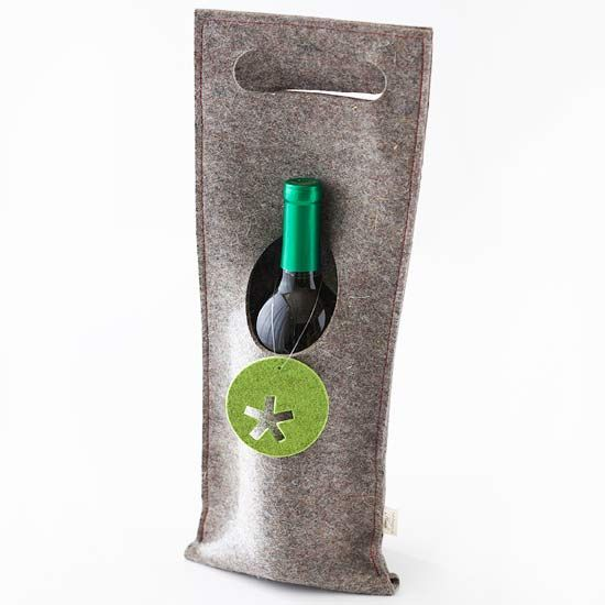Festive Felt Wine Wrap ~ Keep your wine snug with this cozy wine wrap. Use store-bought felt and sew the edges together with red thread to make a rectangle large enough for a wine bottle. Cut an oval shape in the side so the bottle can stick its neck through. Add a handle to the top with a cut oval and a punched star shape in a green felt circle to finish this wrap.