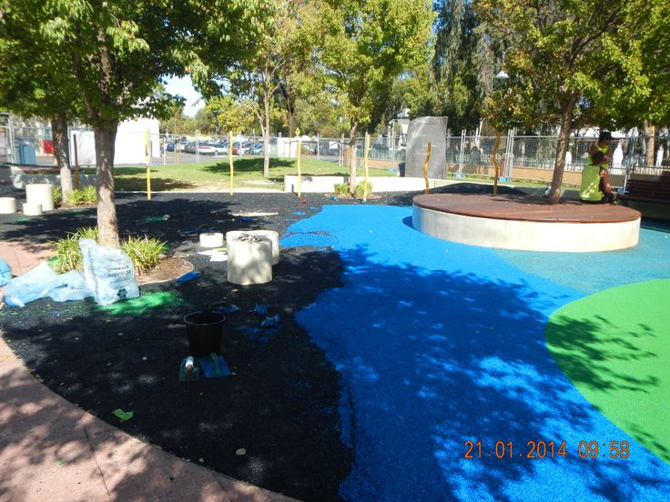 Civic Square - The bright blue soft-fall rubber and a new timber deck around one of the existing trees – this will be a great spot for parents to sit in the shade whilst watching their children play. #renewal 21-01-2014