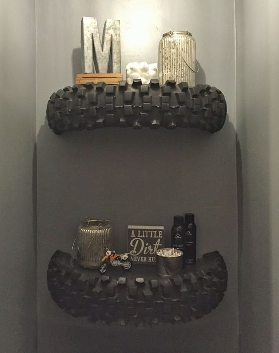 Dirtbike tire shelves we made and mounted above our toilet!