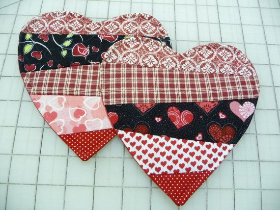 Set of 2 Mug Rugs - Coasters - Candle Mats - Tiny Doilies These patchwork mug rugs feature pretty fabrics in shades of red and pink. Youll