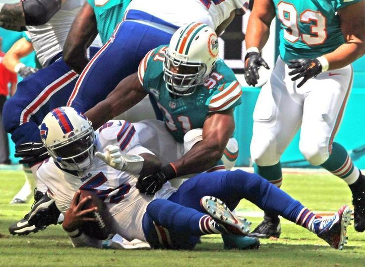 Bills vs. Dolphins:    October 23, 2016  -  28-25, Dolphins  -     Miami Dolphins Cameron Wake sacks Buffalo Bills Tyrod Taylor in the first quarter at Hard Rock Stadium in Miami Gardens, Florida, October 23, 2016.  CHARLES TRAINOR JR ctrainor@miamiherald.com