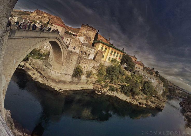 Inspiring architecture of Old Bridge in Mostar. Visit our website: www.tourguidemostar.com #mondaymotivation #tourguidemostar #cityscape #lonelyplanet #cityscape #architecture #oldbridge #flowers #oldbridge #starimost #mostar