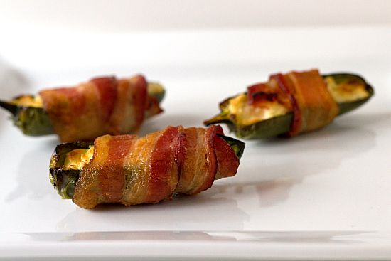Bacon-Wrapped Jalapenos:  10-12 jalapenos, cut in half with seeds removed. 1-2 packages of bacon.  2 packages of cream cheese.  Fill jalapenos with cream cheese, wrap with a piece of bacon (or half to conserve bacon, if you wish).  I secure mine with toothpicks at either end and bake on an aluminum foil wrapped pan at 350 for about 45 minutes.  I like my bacon crispy!