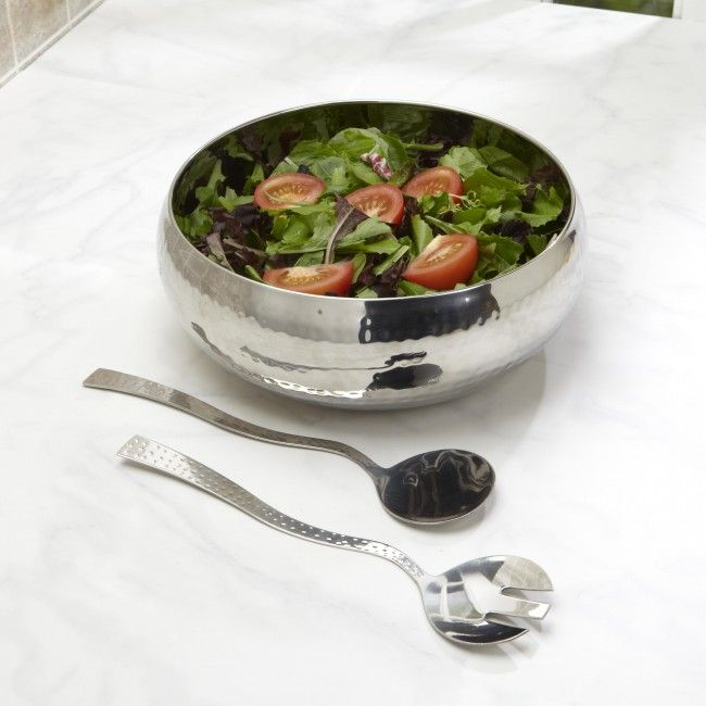 A classic piece of serve ware, the Mann Hammered Stainless Steel Salad Bowl brings functionality, beauty and creativity to your table decor with its timeless quality.