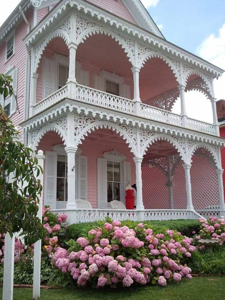 The Pink House, or Eldridge Johnson House, on Cape May is said to the fanciest porch trim in the city. The 1892 house is characterized by pierced wooden balusters, a two-story porch, bargeboard and finial on the gable end, decorative cornices on the first and second story windows and round arched windows on the second story. It was moved to its Perry Street location from Congress Street location in the 1970s.