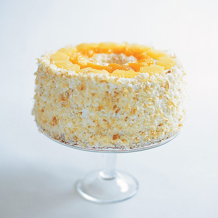 Our recipe for coconut-y Ambrosia Cake from the Cook's Country Fair: Frosted Layer Cake Competition.