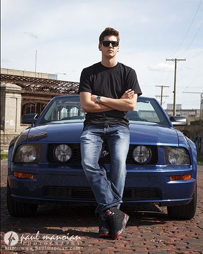 Detroit urban blight senior pictures with cobblestone road a Ford Mustang