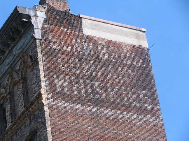 Old Painted Sign On Side Of Building