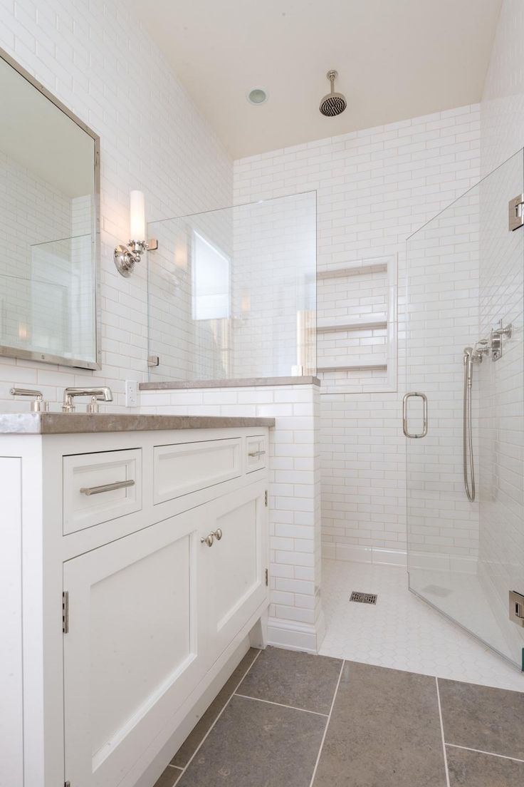this basic bathroom style becomes more streamlined and with tile walls shelving built into