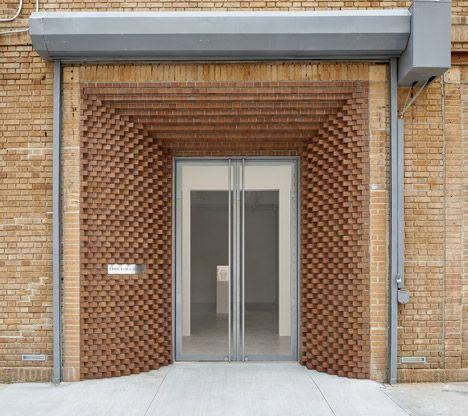 SO-IL adds decorative brick entrance to Tina Kim Gallery gallery in Manhattan.