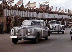 Close up of Mike with Jaguar Mark VIIM, LWK 343, at Silverstone in 1955. Mike won the Silverstone Production Car Race in this car