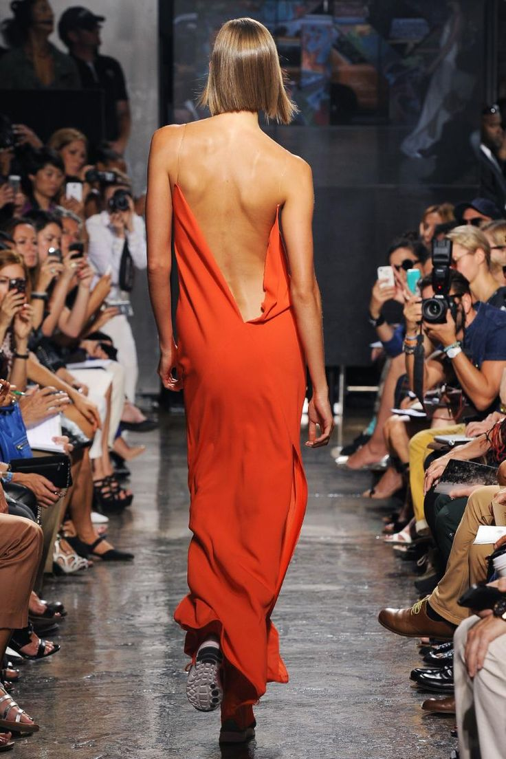 Karlie Kloss at DKNY S/S2014. For a back like hers, try a low-sodium diet and lots of weight-training with low weight and high reps.