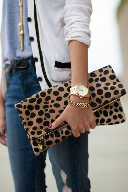 Street deets: a leo clutch and a varsity vibe. Love that.