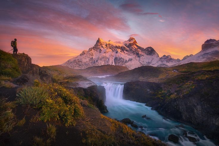 This is Torres Del Paine and the Paine Grande Peaks at sunrise.  My friend, world-class photographer, naturalist, writer, phd scientist, super-hiker extraordinaire and all around amazing person Floris Van Breugel takes a look at the grand surroundings on a magical morning.  He had no idea he'd wandered into my shot.....