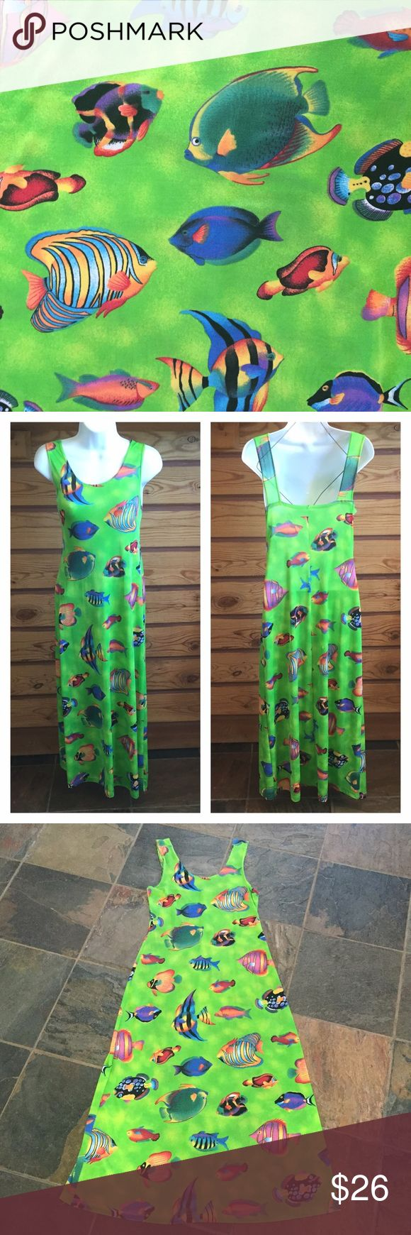 """Summer Tropical Fish Lime Green Slinky Maxi Dress Gorgeous, slinky, sexy, & fun!! Sleeveless maxi dress in electric lime green with an all-over print of tropical fish. Slinky & clingy fabric shows off your curves. Made by Coco's Family. 90% Polyester & 10% Lycra. Size Medium. Dress is 49"""" long. Cocos Family Dresses Maxi"""