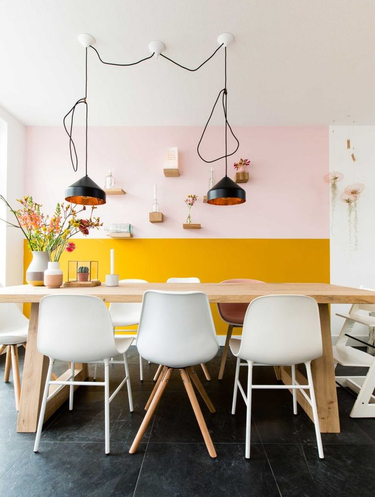 If you're looking for a stunning way to perk up your pastel space, break out the ochre wall paint for a half wall.