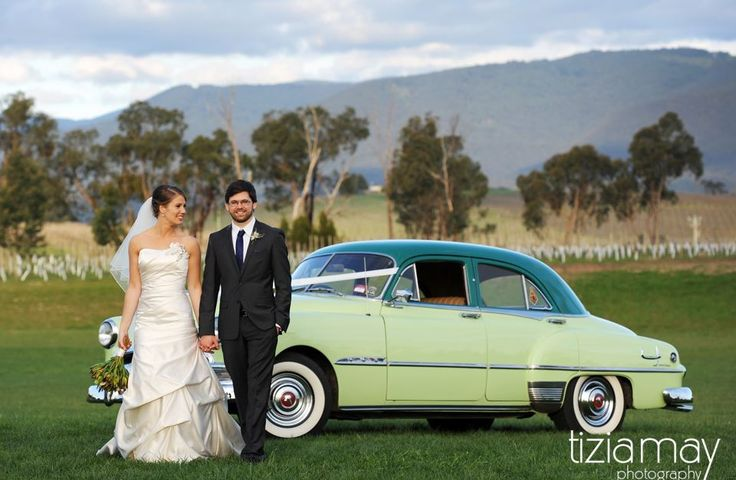 Wedding photos on the lawn with mountain views in the background