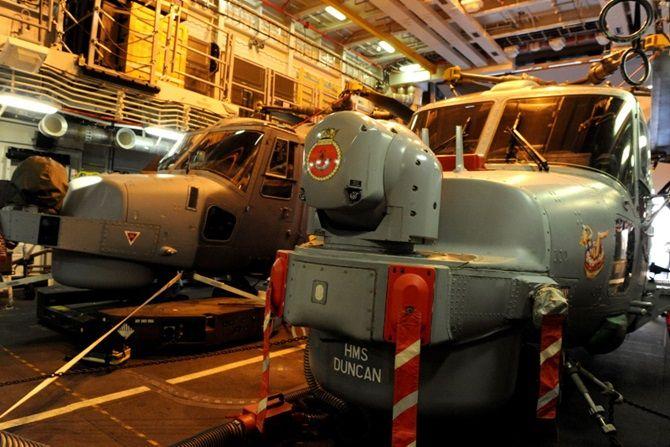 HMS Duncan Op Kipion. Wild Cat helicopter arrives on HMS Duncan