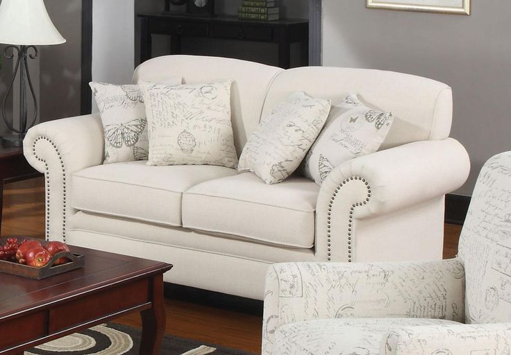 Wood Frame Oatmeal Finish Solid wood legs Plush rolled arms and scalloped shape back Nailhead trim Pocket coil seating Butterfly accent pillows & French script accent pillows included Linen Fabric