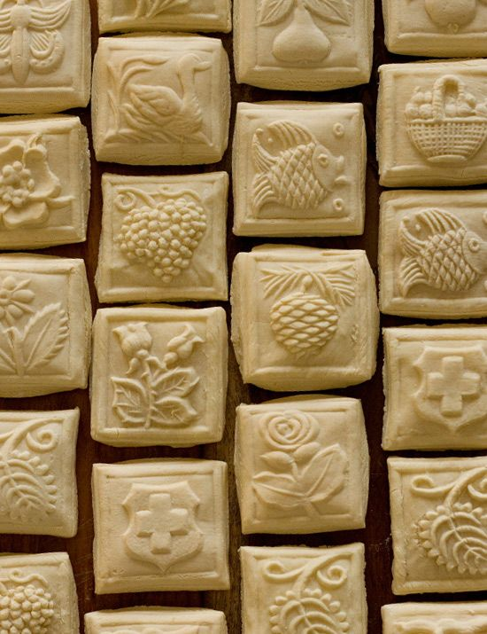 Springerle cookies, produced from cookie moulds dating back to the 14th Century. Used for important announcements and communications of the day: weddings, births, political satire, holidays, harvest times.