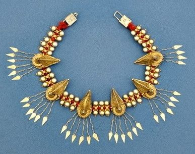 """See p. 180 of Truus Daalder, *Ethnic Jewellery and Adornment*: """"Silver-gilt head decoration for bridegrooms ('sertali ruma-ruma'). Indonesia, Sumatra: Batak people; early 20th c, W (spread out) 51 cm. Gilt silver, red wool."""" We bought this c. 1990 in Amsterdam, where over the years we have found it possible to locate good early pieces, though they are now harder to come by. This is part of the Truus and Joost Daalder collection."""