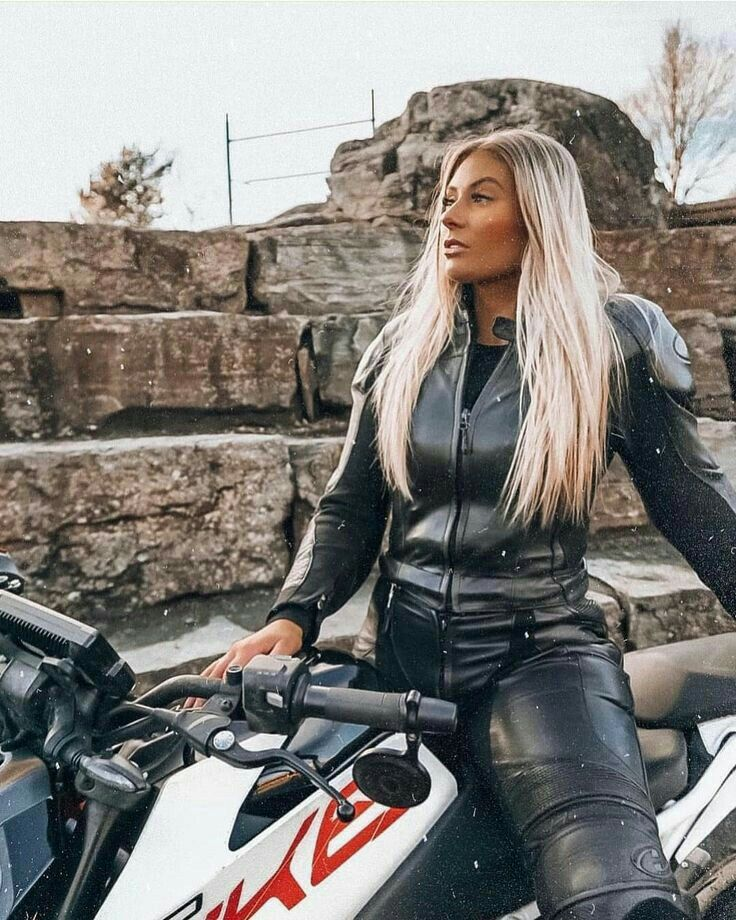 Hot blonde biker in black riding leathers