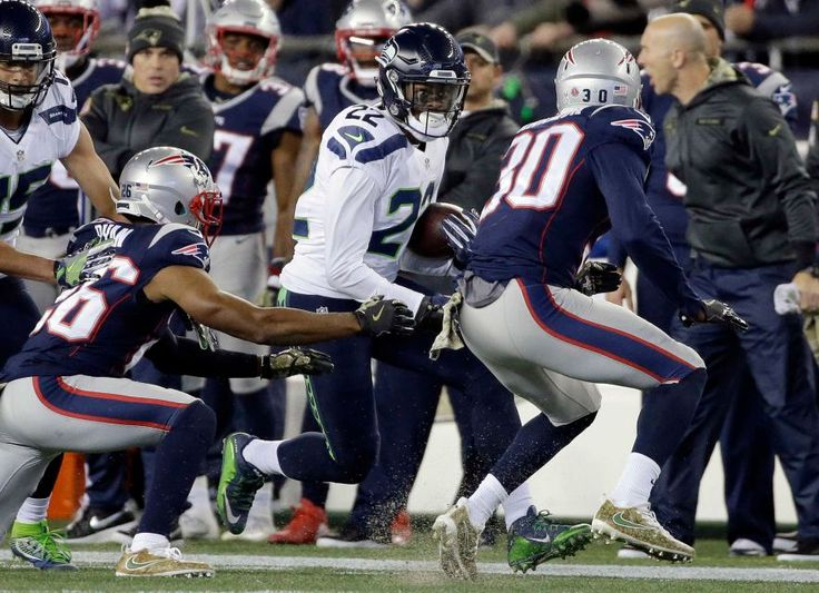 Seahawks vs. Patriots:  31-24, Seahawks  -  November 10, 2016  -  New England Patriots defensive backs Logan Ryan and Duron Harmon chase Seattle Seahawks running back C.J. Prosise during the first half of an NFL football game, Sunday, Nov. 13, 2016, in Foxborough, Mass.