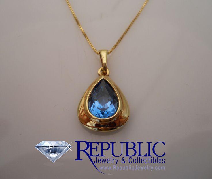 14 karat pendant featuring a stunning caribbean blue