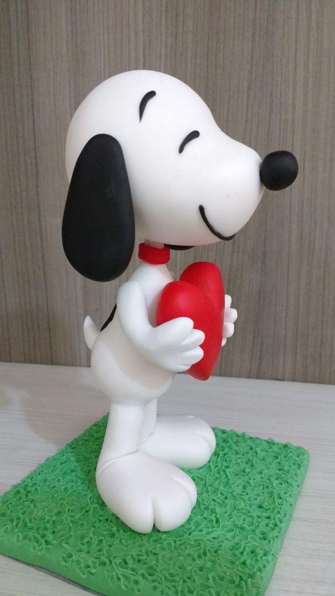 Snoopy em biscuit Peça com aprox. 18 cm de altura. Consulte valor para outros modelos e tamanhos