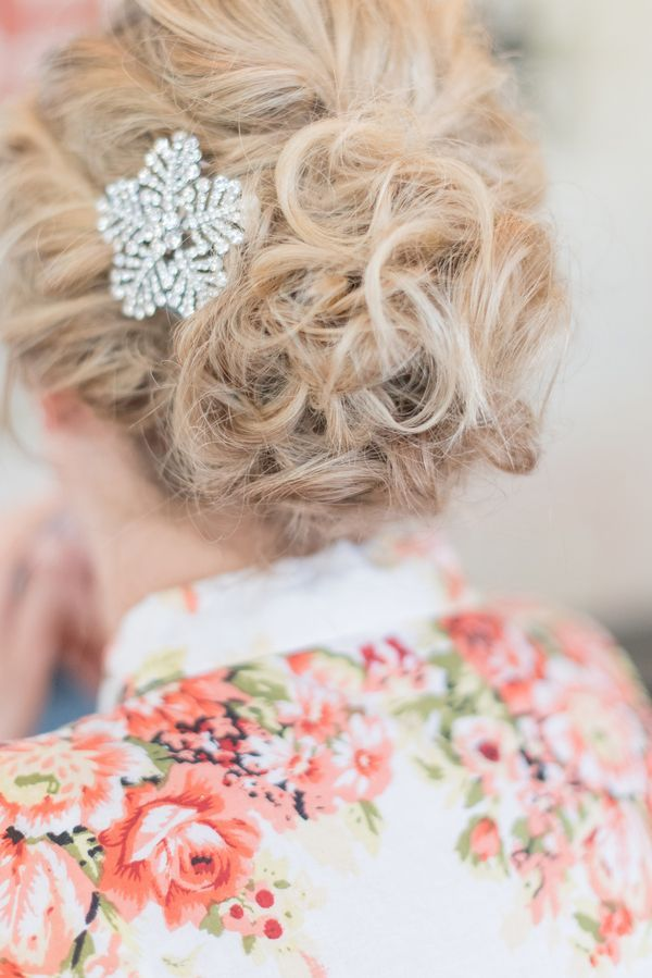 Rachel adorned her classic updo with a shimmery crystal snowflake. | Photo by Katie Lindgren