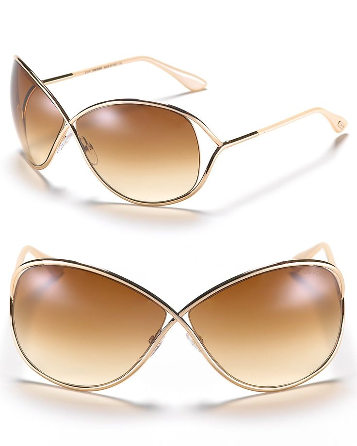 Tom Ford's oversized sunglasses are full of movie-star chic. With cross-front metal frames and exposed lenses. Adjustable nose piece helps to secure fit. | Metal frames with brown gradient lenses | Sc