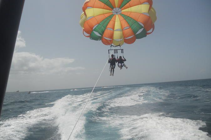 Parasail Over Cabbage Beach Parasail over the clear blue crystal waters of Cabbage Beach, Paradise Island. This amazing ride will leave you breathless and keep you coming back for more. This is an experience like no other that the whole family will enjoy.Complimentary pick up and drop off from local hotels or the cruise ship port in included in this activity.You will be transported to your destination, where our highly competent water sport team will assist you onboard the pa...