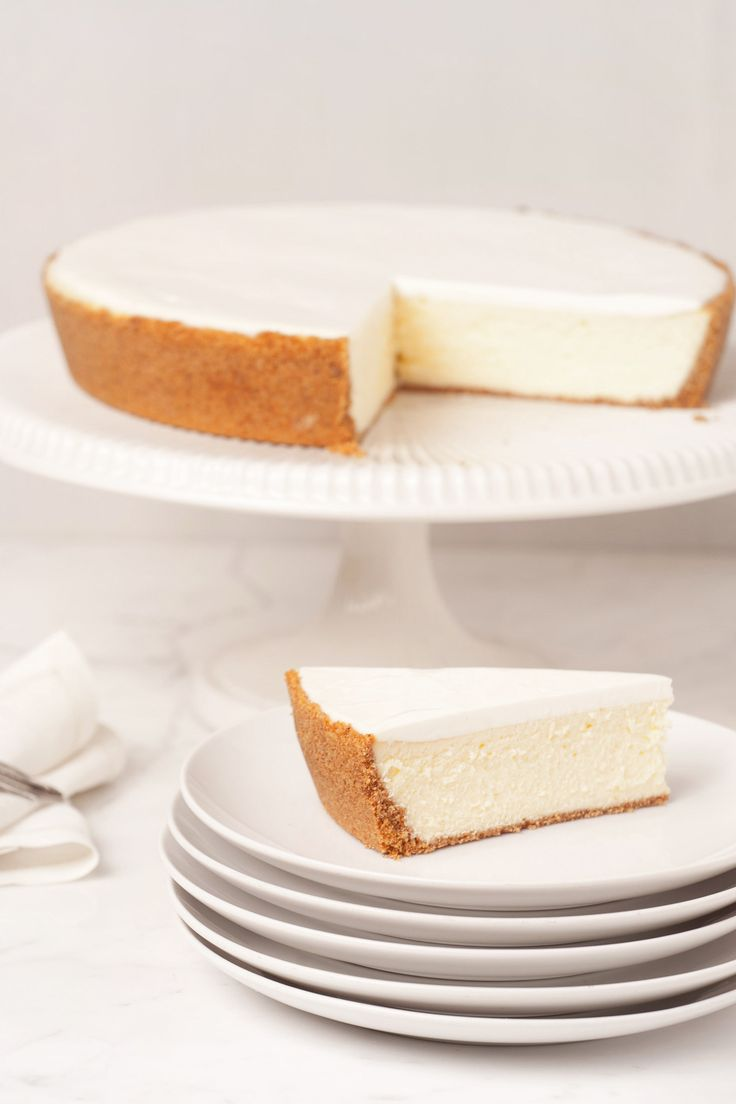 """Gâteau Nuage translates to """"cloud cake,"""" and that's exactly what this sophisticated version of the classic cheesecakes offers. Cinnamon-kissed graham cracker crust meets an airy whipped cheesecake base. At the top, a thin layer of sweetened sour cream – silky finish to a perfect cheesecake."""