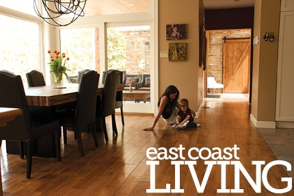 Natural light from large windows floods this open concept space, highlighting the home's hardwood floors. Featured in the Summer 2012 issue of East Coast Living. Photo by Joanna Nickerson, Studio Rouge