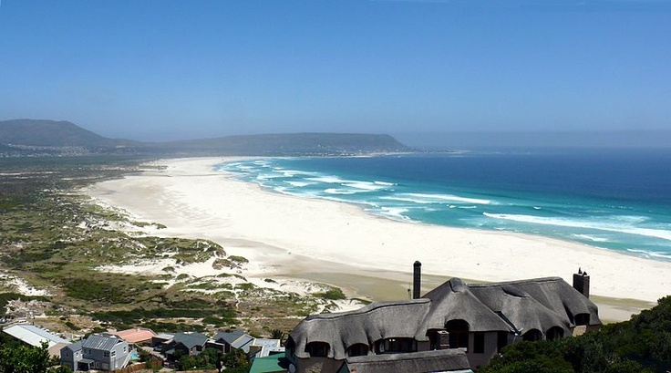 Noordhoek Beach with views of Kommetjie in the distance.