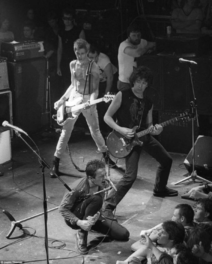 Iconic photo of The Clash performing live at Music Machine in Camden, London, on July 26, 1978, and featuring Steve Jones of The Sex Pistols for the encores, as documented by Justin Thomas.