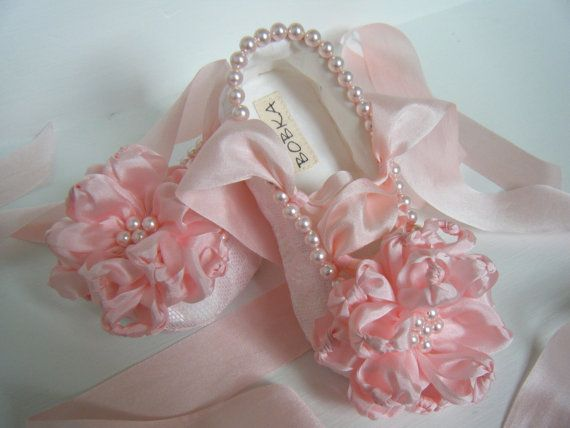 Baby booties with pearls and silk ribbon flowers.