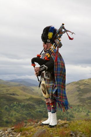 Scottish Piper. by angie rule