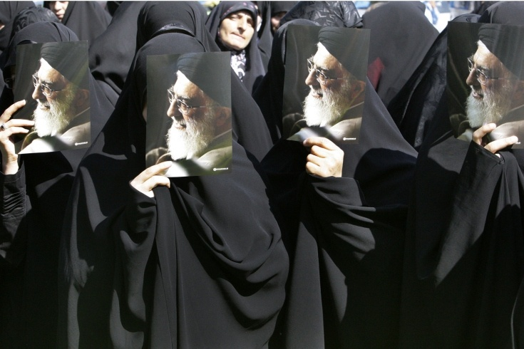Sept. 29, 2012. Iranian seminary students hold posters of supreme leader Ayatollah Ali Khamenei at a demonstration of clerics to protest a film ridiculing Islam's Prophet Muhammad in Tehran.